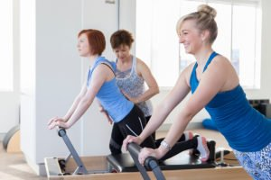 Claire teaching reformer Pilates exercises