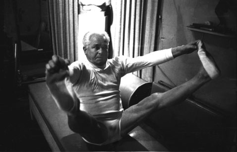 Founder of the method, Joseph Pilates, demonstrates one of his exercises