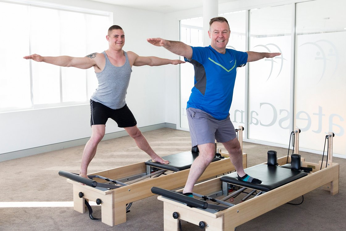 People Using Pilates Equipment
