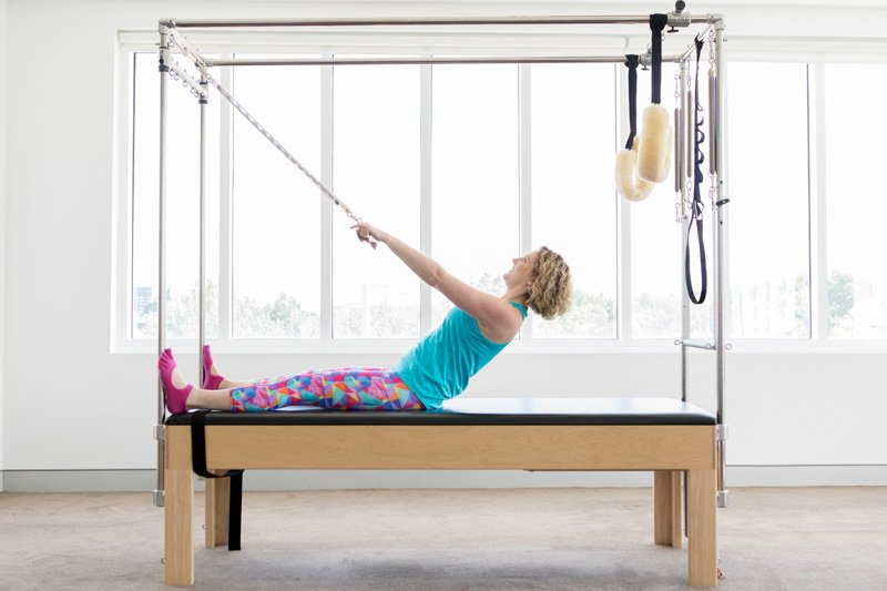 Emma (the article's author) on Trapeze table